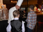 Chef consulting with one of Santa's Elves.